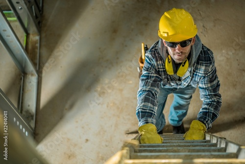 Fotografie, Obraz Contractor on a Ladder