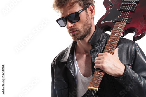 portrait of sexy guitarist with sunglasses looking down to side Fototapeta