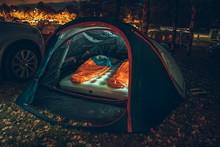 Illuminated Tent On Campsite