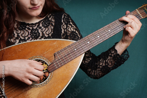 close-up of female hands playing old vintage lute string instrument Canvas Print