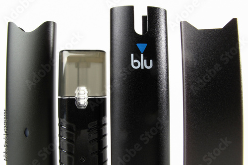 An electronic cigarette device made by JUUL is shown next to