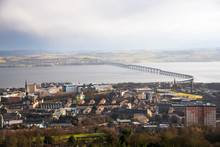 View Of Dundee City Centre And The Railway Bridge Across The Firth Of Tay During Heavy Rainfall In Winter