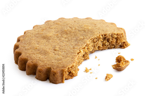 Tablou Canvas Partially eaten round gingerbread biscuit isolated on white