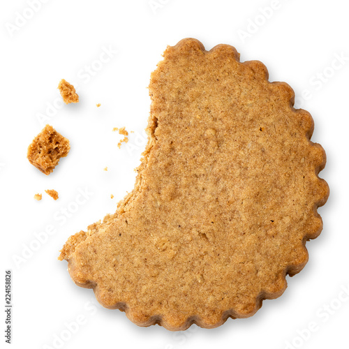 Vászonkép Partially eaten round gingerbread biscuit isolated on white from above