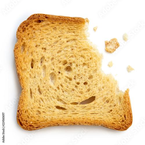 Partially eaten plain melba toast isolated on white from above.