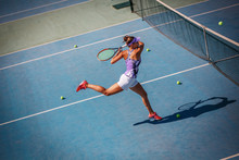 Female Tennis Player Hits The ...