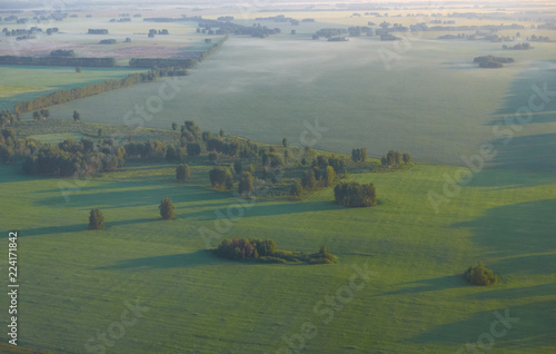 West-Siberian plain. Bird's eye view from plane. Forest-steppe rural landscape