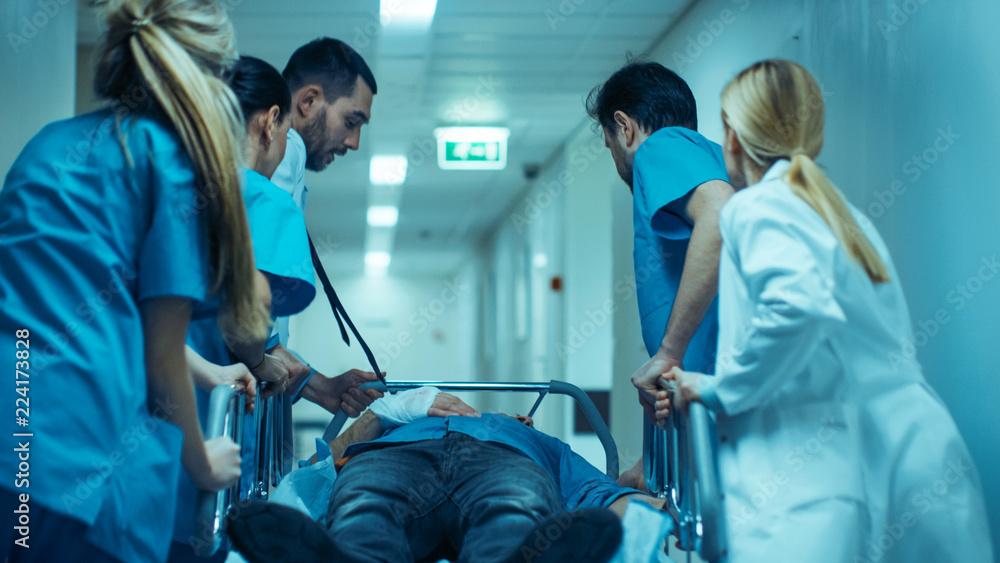 Fototapety, obrazy: Emergency Department: Doctors, Nurses and Surgeons Move Seriously Injured Patient Lying on a Stretcher Through Hospital Corridors. Medical Staff in a Hurry Move Patient into Operating Theater.