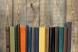 canvas print picture - Ancient books in a row on wooden