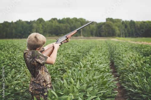 Photo  Boy With Shotgun While Dove Hunting