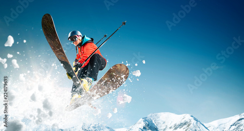 Valokuvatapetti Skiing. Jumping skier. Extreme winter sports.