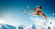 canvas print picture - Skiing. Jumping skier. Extreme winter sports.