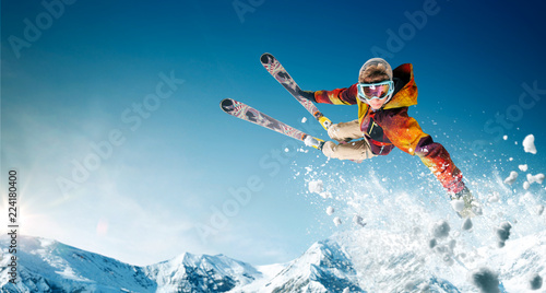 Fotografía Skiing. Jumping skier. Extreme winter sports.