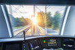 Driver's cab of speed passenger train, view of the railway bridge with the effect of speed motion blur.