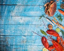 Fresh Tasty Seafood Served On Old Wooden Table.