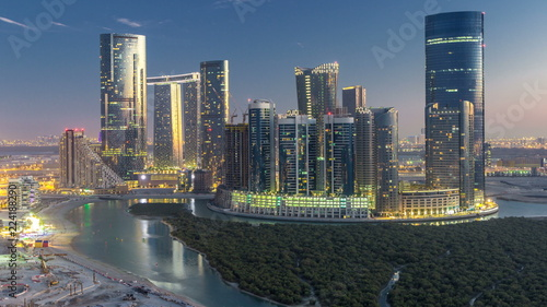 Poster Abou Dabi Buildings on Al Reem island in Abu Dhabi day to night timelapse from above.