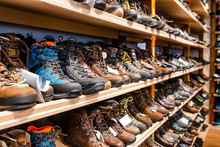 Many Pairs Of Hiking, Trekking And Mountaineering Boots For Sale At Travel Shop