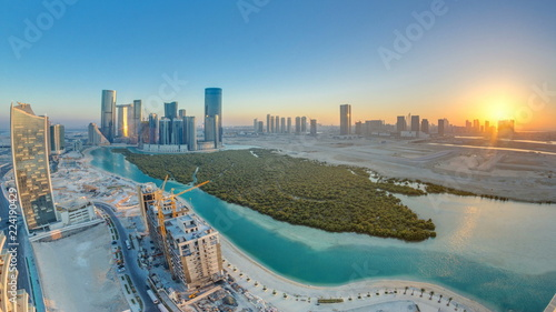 Fényképezés  Buildings on Al Reem island in Abu Dhabi at sunset timelapse from above