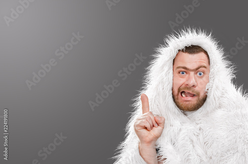 Photo  Caveman in animal skin on isolated background shows thumb up