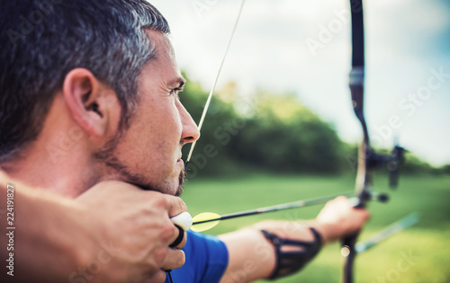 Archer. Sportsman practicing archery. Sport, recreation concept Canvas Print