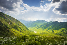Mountains Ranges. Mountain Landscape In Svaneti, Georgia. Beautiful View On Grassy Hills And Highlands On Summer Sunny Day With Cloudy Sky. Scenery Mountains Nature.