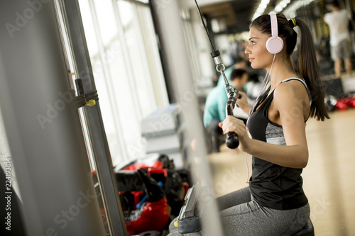 Young woman exercises in the gym