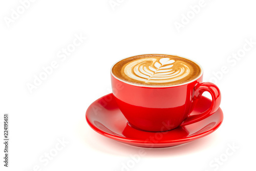 Side view of hot latte coffee with latte art in a bright red cup and saucer isolated on white background with clipping path inside.