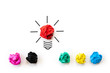 Inspiration and great idea concept. light bulb with crumpled colorful paper on white background.