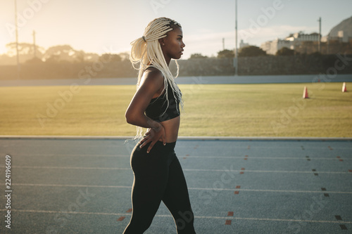 Photo Sprinter walking on running track