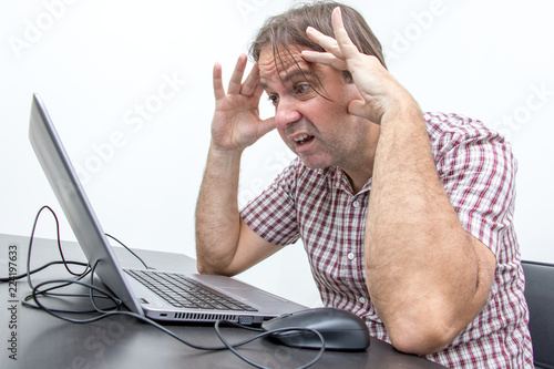 The confused unhappy user is looking at the computer screen Canvas Print