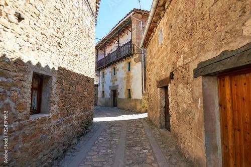 Tuinposter Oude verlaten gebouwen Narrow street in the historic town of Orbaneja del Castillo