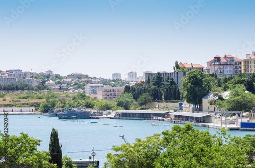City on the water Russia, the Republic of Crimea, Sevastopol. Sea pier in the quarantine bay, city view