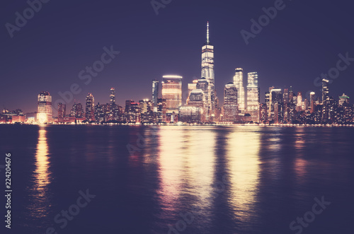 Deurstickers New York City Manhattan skyline at night, color toning applied, USA.