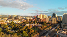 ADELAIDE, AUSTRALIA - SEPTEMBER 16, 2018: Aerial View Of City Skyline At Sunset. Adelaide Is The Main City Of South Australia State