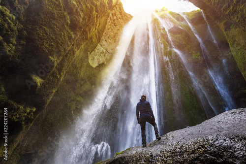 Photo Gljufrabui waterfall in South Iceland,  adventurous traveller standing in front