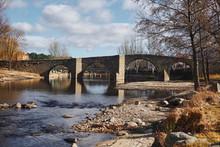 Bridge Over Calm Blue River