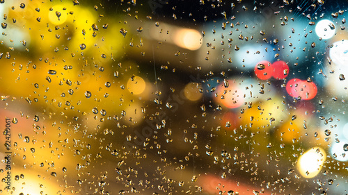 view of blurred urban lights through drops