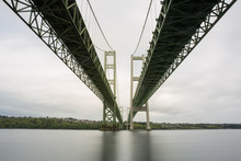 Under The Tacoma Narrows Bridge With A Long Exposure Of River