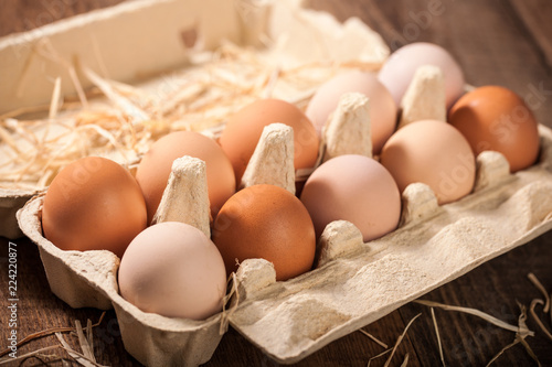 Fresh chicken eggs in cardboard box
