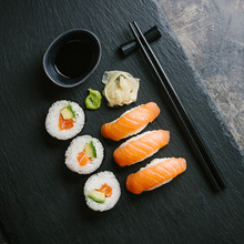 Sushi Served On Plate On Dark Table