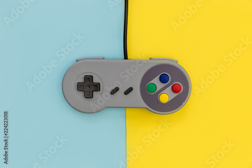Retro video game controller yellow blue background Wallpaper Mural