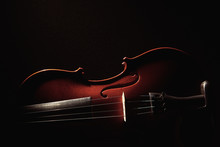 Part Of A Violin On A Black Ba...
