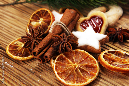 Tuinposter Kruiderij Baking christmas cookies. Typical cinnamon stars bakery with spices. xmas decoration