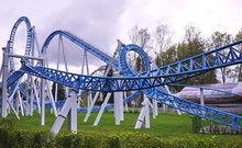 Attractions: Ferris Wheel, Roller Coaster And Rocket In The Park.