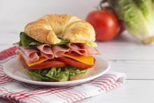 Ham And Cheese Sandwhich With Lettuce Cheese And Tomatoes