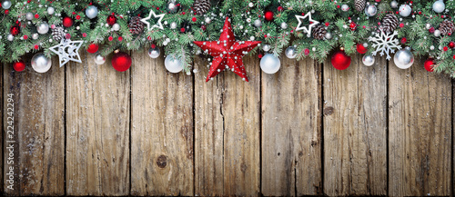 Leinwand Poster Christmas Ornament With Fir Branches On Aged Wood