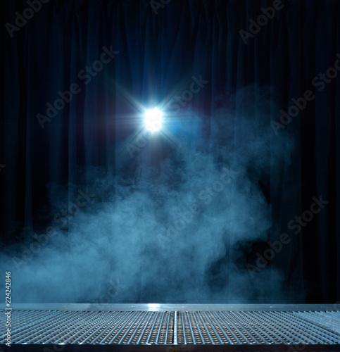 Spotlight shining on curtain