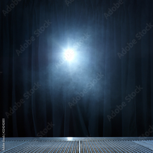 Spotlight shining on curtain