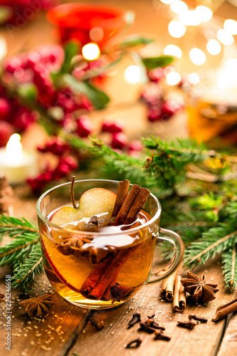 Staande foto Bier / Cider Mulled cider with cinnamon, cloves and anise. Traditional Christmas drink