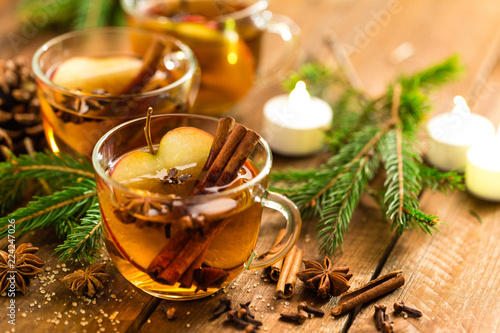 Fotobehang Bier / Cider Mulled cider with cinnamon, cloves and anise. Traditional Christmas drink